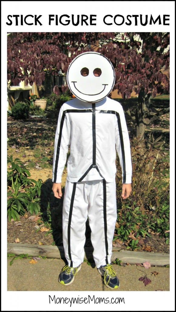 white long sleeve shirt and white pants with black electric tap in the shape of a stick figure costume and a white posterboard smiley face for mask creative DIY Halloween costume