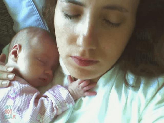 sleeping mother holding sleeping newborn baby