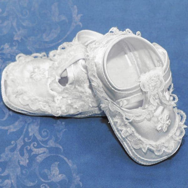 newborn lacy white shoes on blue background