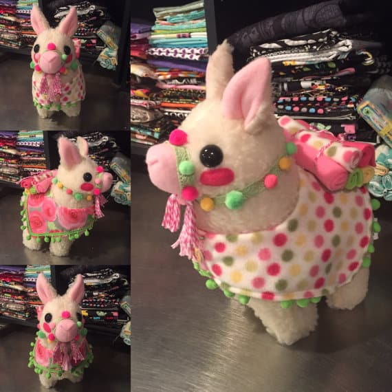 white plush llama with pink ears and blanket
