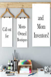 desk with art supplies and poster boards on hangers with words