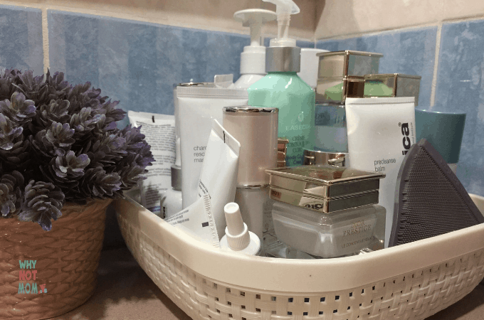 plastic container containing various skin care products lotions and moisturizers next to a succulent plant