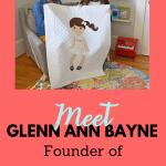 Glenn Ann Bayne with sister Laura holding her creation of a Paper Doll Blanket