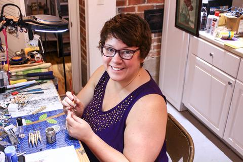 photo of Jeana Rushton jewelry designer for The Fox and Stone in her studio making jewelry