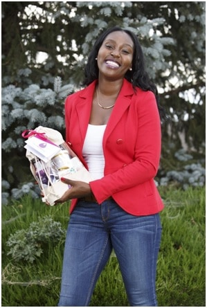 Mom Entrepeneur Ericka Perry holding her product The Stork Bag a gift subscription for pregnant and postpartum women